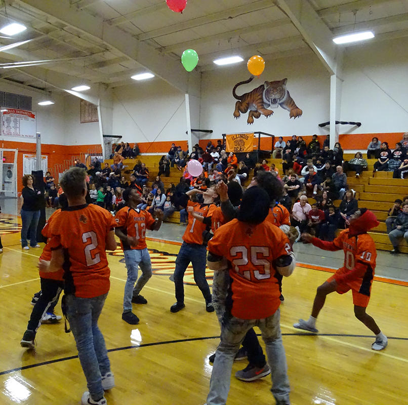Students participating in pep rally games.